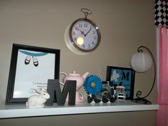 "The shelf in our Alice in Wonderland themed nursery. Several DIY projects assembled here to create our ""alice"" feel!"