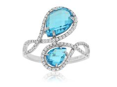 This stunning Blue Topaz Ring features 0.35 ct of Diamond and 3 ct of Blue Topaz. The Ring is made of 14K White Gold