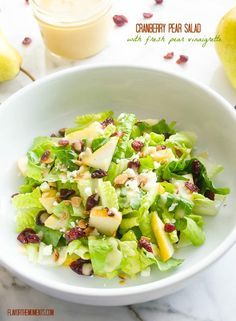 Cranberry Pear Salad with Fresh Pear Vinaigrette is crisp romaine lettuce tossed with sliced pear, dried cranberries, feta cheese, and toasted almonds and a fresh pear vinaigrette.
