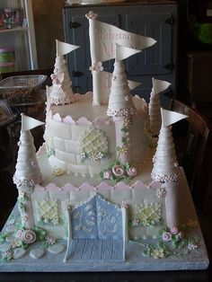 Castle cake....window details...flowers at the turret bases....monochromatic....overall look....delicate....