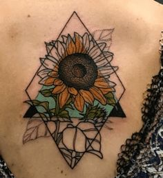This back tattoo of a geometric sunflower is so trippy! Check out the 50 most stunning back tattoos at CafeMom.com. #tattoos #tattooideas #tattoodesign