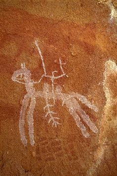 Ennedi Plateau. Warrior mounted on horse. Note bichrome grid below horse.
