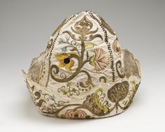 Man's at-home cap, probably France, 1725-1775. Cream silk plain weave with supplementary warp-float patterning, and silk and metallic-thread embroidery.