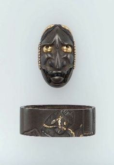 Fuchi-kashira with designs of Hannya mask and horse Japanese, Edo Period, Early 19th century Shigetoshi, Japanese, about 1800, Main material: shibuichi; other metals: gold, silver, shakudo and copper; decorative technique: takabori, zogan, MFA