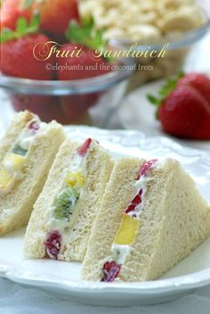 Fruit Sandwich Fruit Sandwich = I'll try using Greek Yogurt to replace Cream Cheese and Heavy Cream in the sandwich. The filling won't be as firm, but it should still taste good, and have MANY fewer PointsPlus! Fruit Sandwich, Sandwich Cake, Sandwich Ideas, Tea Party Sandwiches, Finger Sandwiches, Tea Recipes, Cooking Recipes, Tapas, High Tea