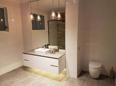 We love the simplicity and versatility of this bathroom. Nice clean lines on the vanity unit plus an in-wall toilet subtly tucked in there, we could see this modern bathroom in a variety of homes!