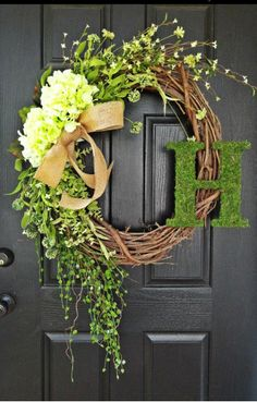 monogram wreath with willow frame and branches. pretty spring wreath