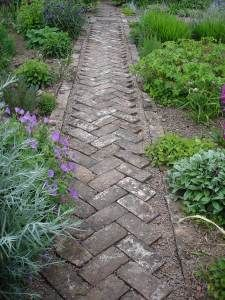 herringbone pathway.  Interesting idea for the border-- gravel between stone and edger
