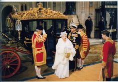 The Queen arrives in the Australian State Coach, which was also built by Jim Frecklington.