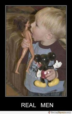 Amusing boy is playing with toys like a real man
