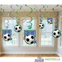 Soccer Swirls Decoration Pack | PARTYZILLA  Pack of 5. Each blue or green swirl measures approx. 60.96cm long and ends in a soccer ball cutout measuring 12cm in diameter.  These look great above the cake table or in the door ways. Visit www.partyzilla.com.au for Kids Party Supplies, Gifts and more!