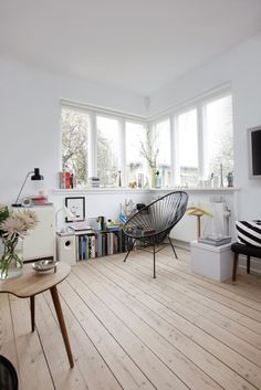 white. wood floor. windows.