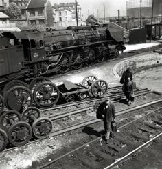 Workers at the engine depot of the SNCF (French National Railway Corporation). Paris, Porte de la Chapelle, Photograph by Janine Niepce Holland, Old Paris, Repair Shop, Round House, Steam Engine, Steam Locomotive, Museum Of Modern Art, Model Trains, The Dreamers