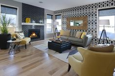 This gorgeous room in the Bentley showhome has beautiful dark grey tiling on the fireplace with a black and white accent wall that really makes it pop! #morrisonhomes