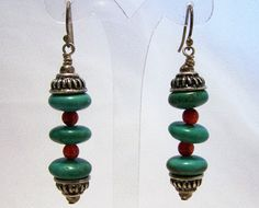 Vintage Southwestern style artisan turquoise and carnelian bead earrings Sterling silver French hook finding Silver tone beads 2 inch drop, beads are 1 3/4 x 3/8 inches Very good condition, gently owned I specialize in vintage beaded jewelry, please visit my shop for more selections International buyers welcome, overcharges are automatically refunded Priority shipping is optional   Want to see more vintage earrings? Click here: https://www.etsy.com/your/shops&#x2...