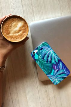 Arguably one of the most popular design trends currently, leaf and palm prints offer more than just another decor style. They allow us to live in a tranquil, tropical oasis. But these designs can make also a phone case very special! This green-blue leaves phone case is available for iPhone and Samsung. #phonecases #phonecovers #iphonecase #iphonecover #yoga Blue Leaves, Tropical Plants, Phone Covers, Decor Styles, Design Trends, Blue Green, Sunglasses Case, Iphone Cases, Oasis