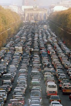 Aerial view of a traffic jam on November 11, 1989 at the Strasse des 17. Juni with the Brandenburg Gate in the background as thousands of East German citizens move into West Berlin after the opening of the wall by the East German government.