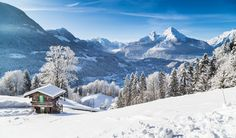 Winter wonderland in the Alps with mountain chalet