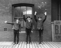 Staff of the Lancashire and Yorkshire Railway demonstrating hand signals. 1910