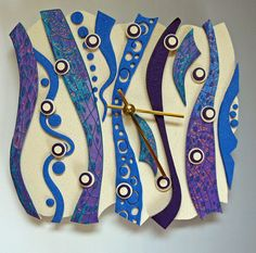 Blue Sky Time Unique Polymer Clay Art Clock. Free Form in Rainbow Retro, Crazy Stripe on Purple. $75.00, via Etsy.