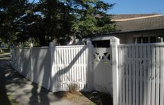 Capped Picket Fence with a Timber Feature Gate