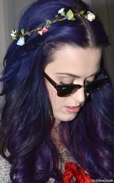 Katy Perry. Her fearlessness to be herself and express her inner weirdness. Always flaunting outrageous haircolors and nails. Her live shows are always over the top. This is someone who knows themselves and doesn't care what other people think.