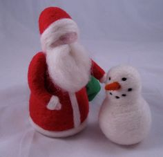 This cheery fellow is made entirely of wool, needle felted by hand. Made in the waldorf tradition, he would be a very welcome guest at any dollhouse or nature corner! You will receive actual Santa pictured in photo. He comes with a green wool felt bag to hide a surprise in. Santa measures about 5 inches tall. Mouse and snowman are not included in this listing.
