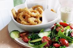 1 1/2 cups (150g) dry breadcrumbs Finely grated zest of 2 lemons, plus juice of 1/2 lemon 1 cup (150g) plain flour 3 eggs, lightly beaten 400g cleaned squid tubes, sliced into 1cm rings 1 cu...