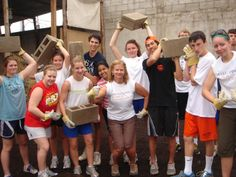 Volunteers building houses for Open Windows Foundation families. San Miguel Dueñas, Guatemala