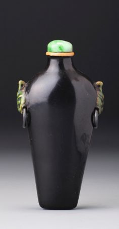 A BLACK LACQUER, BONE AND SILVER 'TAOTIE MASK' SNUFF BOTTLE<br>QING DYNASTY, 18TH / 19TH CENTURY | lot | Sotheby's