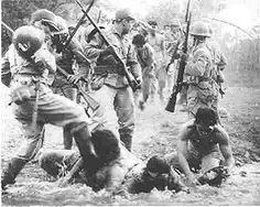 taken during the March and shows Japanese soldiers mistreating Filipino soldiers trying to get water.