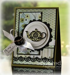 by Amy Shiefler  Stamps: Taylored Expressions-CreativiTEA. Paper: Basic Grey's Kioshi Spellbinders: Circle, Peony. Punch: decorative border. Embellish: white satin ribbon, black button, twine, light blue pearls.
