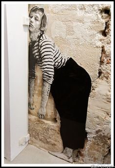 Artist Charles Leval, also known as Levalet engaged street art on the streets of Paris.