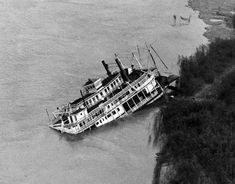 An aerial view of the Golden Eagle at Grand Tower Island in the Mississippi River on May Ship Breaking, Steam Boats, Abandoned Ships, Paddle Boat, Cool Boats, Golden Eagle, Out To Sea, Boat Rental, Boat Design