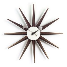Vitra Sunburst Clock designed by George Nelson. Vitra Sunburst Clock is a true Design Classic, very recognisable and timeless in it's design. To this day, his wall clocks remain a refreshing alternative to the usual timekeepers. The Vitra Design museum p George Nelson, Sunburst Clock, Vitra Design Museum, Alexander Girard, Desk Clock, Wall Clocks, Wall Desk, Charles Eames, Design Within Reach