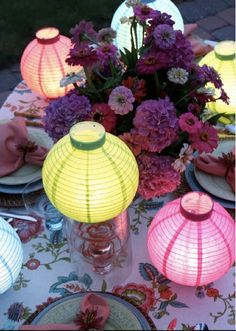 Miniature paper lanterns add a warm glow to a tablescape.