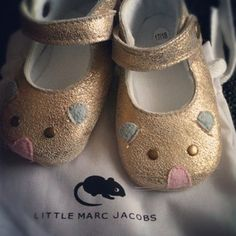 Little Marc Jacobs tiny shoes. I want a pair for my little sweetheart.