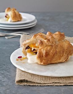 Hidden inside this baked treat: sweet cranberry and apricots, honey, and Brie. #party #appetizers