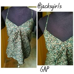"GAP Floral green tank Green and brown tank. Tiny eyelet details. Adjustable straps. 100% cotton. Lined. Wear it over a maxi dress or with a maxi skirt  Length 19"" Chest 17 10% off bundles of 2/more__No Trades__No transactions outside PM__Actual color may vary from picture__Condition is Excellent unless otherwise Stated__Reasonable offers__Measurements taken flat__Thank you GAP Tops Tank Tops"