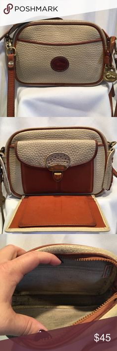 """Auth. Vintage Dooney & Bourke cross body Vintage Small classic cream All Weathered Leather Dooney. Measurements: 8"""" in width by 5.5"""" in height. Has a push clasp organizer for credit cards and ID. Will need to be cleaned, but this little Dooney is in good shape. No rips, or loose threads. Inside has some ink marks. Adjustable strap 23""""-25"""". Perfect for someone who likes to take the essentials with them and doesn't fuss about stuffing her purse full. Perfect for the collector. Dooney & Bourke…"""