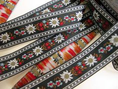 3 yards EDELWEISS & ENZIAN fabric Jacquard trim. White, red, light blue, brown, on black. 3/4 inch wide. 908(3)-A