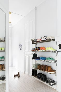 Bright white hallway with entryway shoe storage - could use something like this, but behind closet doors.