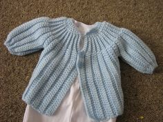 A really cute pattern that is my go to pattern for matinee jackets (free pattern by 'Cats-Rockin-Crochet Fibre Artist')