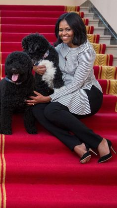 First Lady Michelle Obama with family pets Bo and Sunny.