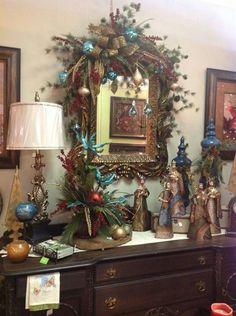 Buffet in jewel tone christmas room. WOW, this is exactly the color scheme and style I want. Peacock Christmas, Christmas Swags, Christmas Room, Christmas Mantels, Noel Christmas, Christmas Entryway, Christmas Scents, Christmas Nativity, Christmas Centerpieces