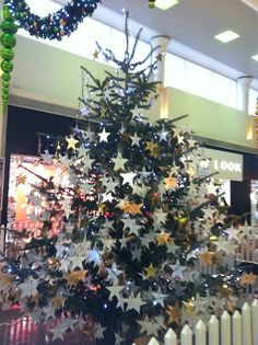 Photo No 354 - Shining Star (Dec Went to do some Christmas shopping in town and gave some money to the hospice that cared for my Auntie last year. I think she's got a couple of shining stars on this tree. Hospice, Shining Star, Auntie, Christmas Shopping, Challenge, Christmas Tree, Couple, Money, Stars
