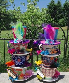 Pair of Mad Hatter Bright Whimsical Stacked Teacup Centerpieces - Alice in Wonderland Decorations Props Tea Party Birthday Bridal Shower by EdieSChicCrafts on Etsy https://www.etsy.com/listing/398292785/pair-of-mad-hatter-bright-whimsical