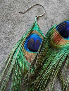 peacock feather earrings. I would wear these.