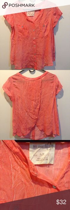 FREE PEOPLE Coral Sheer Button Down Blouse Free People top by We The Free and is coral in color with buttons in the center front. Not lined- sheer fabric with an awesome design that looks like creased denim - very unique. Short sleeves and the back has rounded flaps of fabric for the back panel! Very cute and size small! Runs large. Free People Tops Button Down Shirts
