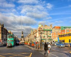 A Winter Stroll in Dublin Ireland - art by Mark E Tisdale - Beautiful Streetscape of the wide boulevard of O'Connell Street in the heart of the Irish capitol. Ireland Homes, Irish Art, Emerald Isle, Dublin Ireland, A Decade, Natural Beauty, Times Square, Street View, City